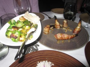 """(L to R) Brussels Sprouts with Shiro Miso-Maple Mustard and Bacon Wrapped """"Fugu"""" Blowfish with Black Garlic, Hearts of Palm, Black Pepper, and Lemon"""