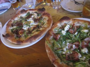 Leeks, Goat Cheese, and Bacon Pizza on Right