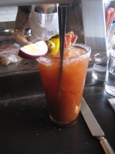 """Olympic Mary,"" with Monopolowa Vodka, house tomato mix, a salt-pepper rim, Calabrian chili, a pickled egg, and of course, a salami swizzle stick"
