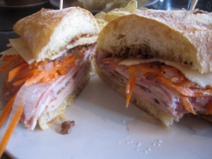 Sandwich with Mortadella, Capicola, Finocchiona, and Provolone, with Pickled Carrots and Olive Tapénade on Ciabatta