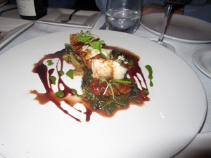 Sautéed Sweetbreads and Monkfish with Melted Greens, Verjus- Red Wine Reduction, and Preserved Orange