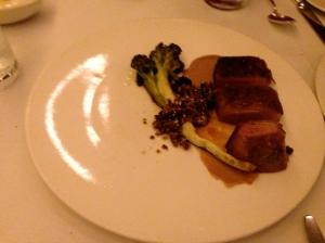 Aged duck breast with broccoli, potato granola, sesame, and raisin cream