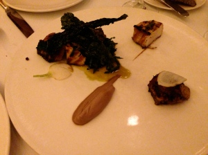 Wood-grilled sturgeon and chicken wings with marinated kale, turnips, and walnut purée