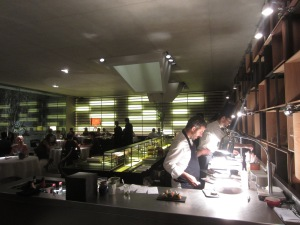 The open kitchen, chef's counter, and the dining room. Chef Felip Llufriu is closest.