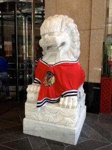 The Peninsula Hotel lion sure is a hockey fan...