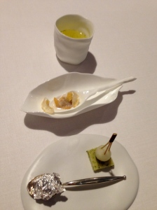 """The Previous"": White garlic soup with mussels, and ""torreznos""; Aromatic water; Seaweed cake with black sausage and melon; ""Ferrero de foie""."