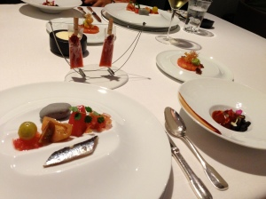 """""""Tomato"""" 2013: Clock-wise from top left: Tomato flash with herbaceous touches; Crispy sponge with tomato sirloin and duck; Roasted tomato into Bourbon barrels; Mediterranean rock with tomatoes of every kind and sardines"""